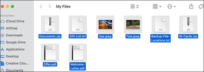 Todos los archivos seleccionados en una ventana del Finder.