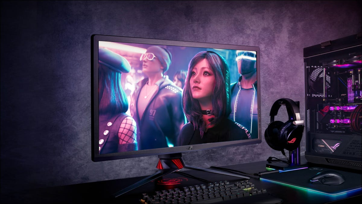 ASUS ROG monitor on desk with game playing